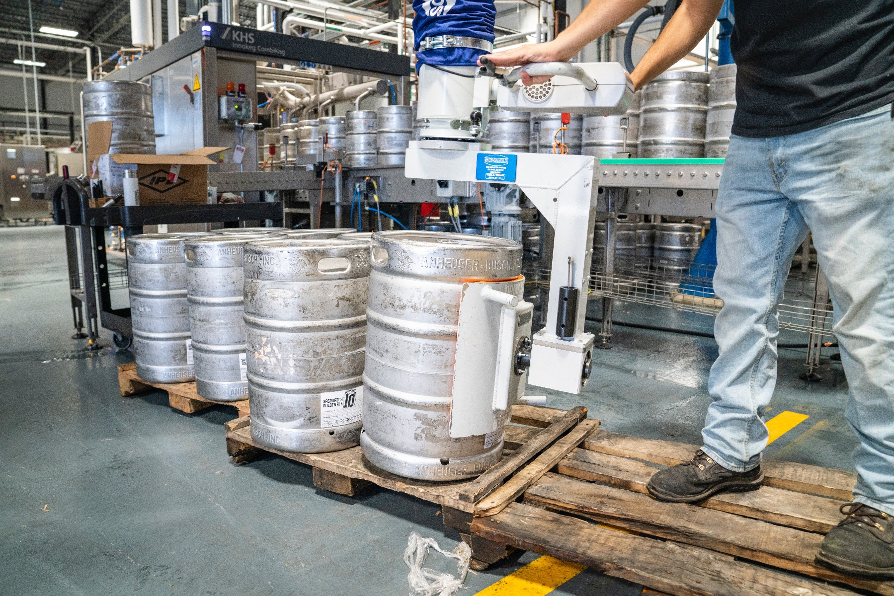 Man handling barrels in warehouse